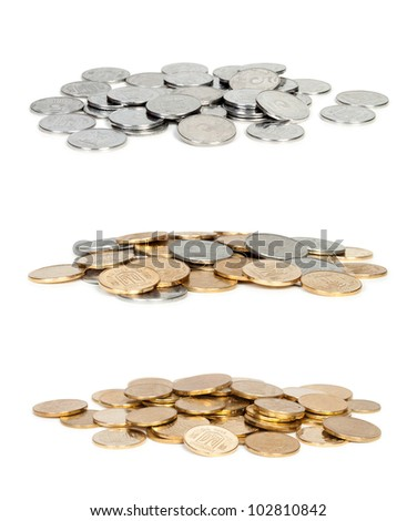 three Heaps of coins isolated on white background - stock photo