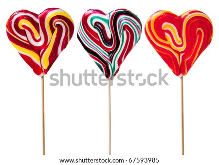 Three Heart Shaped Candy Lollipops, with clipping path - stock photo