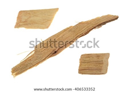 Three hickory wood smoking chips for flavoring barbecue and grilled foods isolated on a white background.