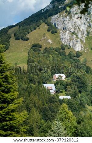 three houses photographed at Piani d'Erna (part of the Alps) near Lake Como in Italy - stock photo