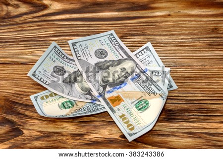Three hundred dollars bills on a wooden background - stock photo