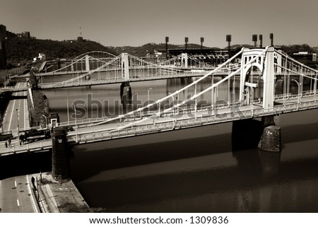 Three identical suspension bridges across a river. Taken in Pittsburgh, PA. - stock photo