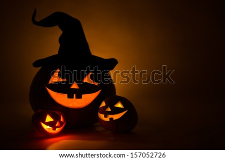Three jack-o-Lantern at dark - stock photo