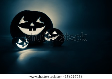 Three jack-o-Lantern in blue at dark