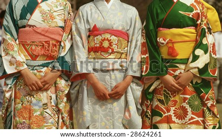 Three Japanese women and their kimonos - stock photo