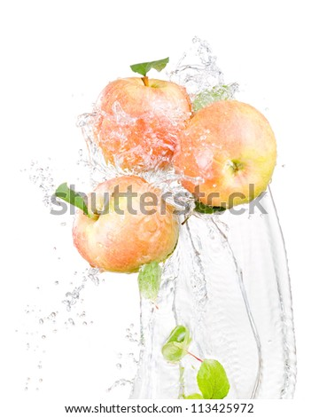 Three juicy red apple in water splash isolated on a white background - stock photo