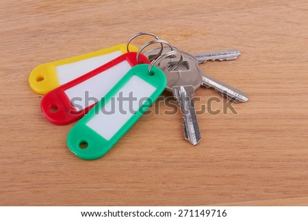 Three keys on a wooden background - stock photo