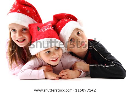 three kids and christmas isolated on the white background - stock photo