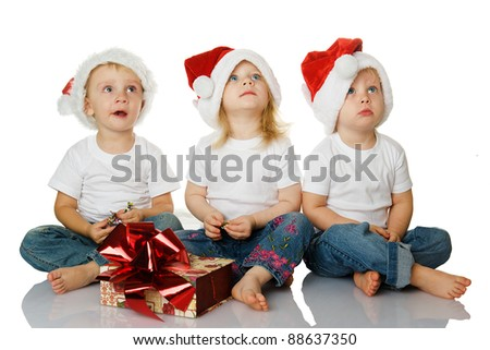 three kids dreaming about christmas isolated on white background - stock photo