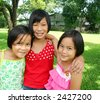 Three kids having good time in the park. - stock photo