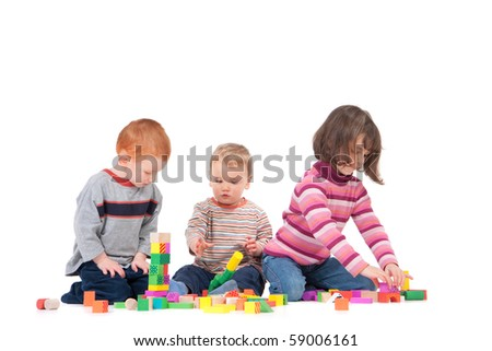 Three kids playing with wooden blocks. Isolated on white, with shadows. - stock photo