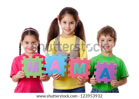 Three kids with colorful letters displays the word Mom, isolated on white - stock photo
