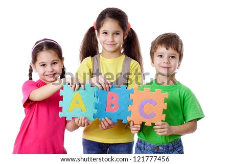 Three kids with colorful letters, isolated on white