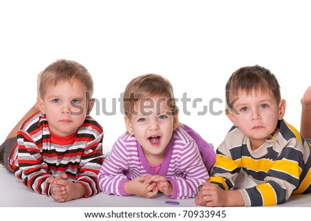 Three kids with different emotions are lying; isolated on the white background - stock photo
