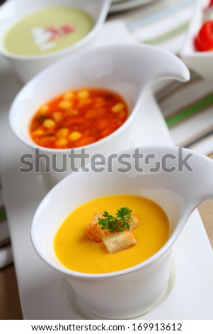 Three kinds of soup on the table.