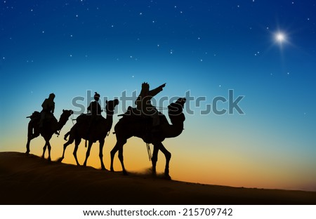 Three kings looking at the star - stock photo