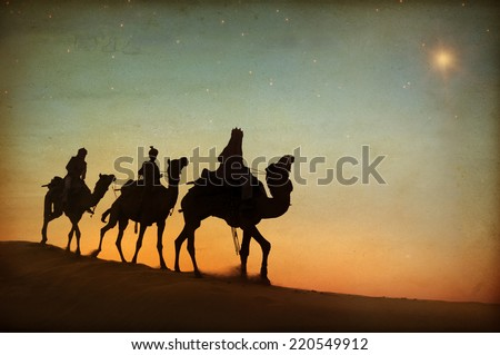 Three kings looking at the star. - stock photo