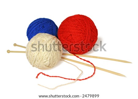 Three knitting balls over white background.