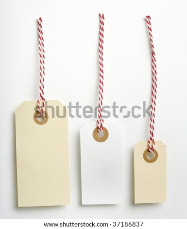 Three labels with a red and white rope isolated on white - stock photo