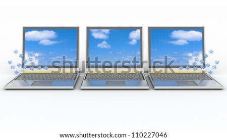three laptops with a screen from puzzle on  white background - stock photo
