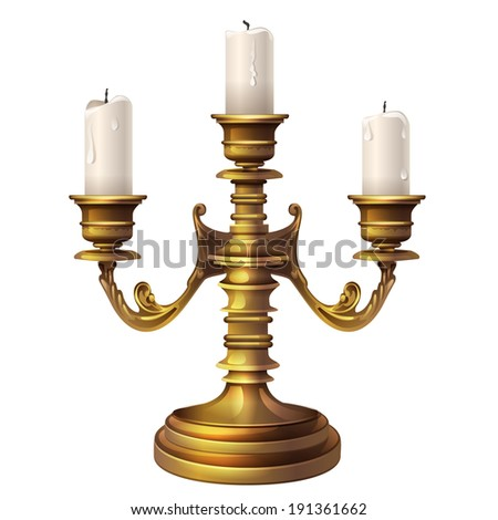 three large candle in a brass candlestick