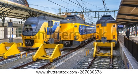 Three large intercity trains on Central Station in Groningen waiting at the platform to leave for Amsterdam. The intercity trains are an important and reliable connection between the north and west - stock photo