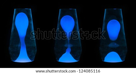 Three lava lamps showing progress of the Blue wax going up and separating - stock photo