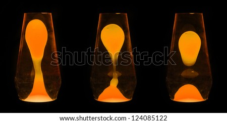 Three lava lamps showing progress of the Orange wax going up and separating - stock photo