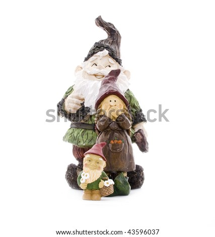 Three Lawn Gnomes Standing in Formation on White - stock photo