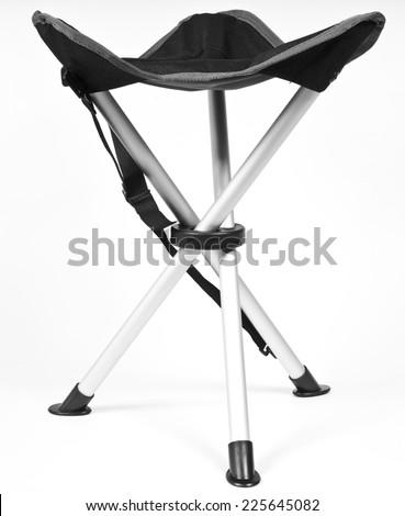 Three-legged folding stool tourist in black and white - stock photo