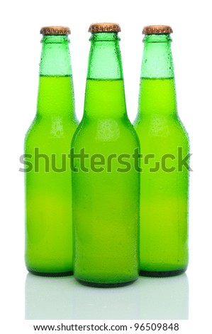 Three Lemon Lime Soda Bottles with condensation in a grouping on white with reflection