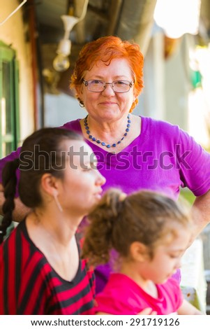 Three levels of a generation: grandmother, mother and child, same family. - stock photo