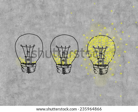 Three light bulbs filled with light drawing on wall