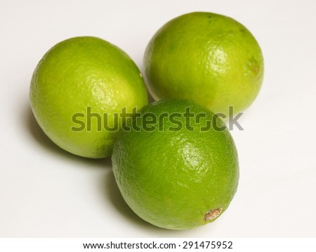 Three lime citrus fruits over white background - stock photo