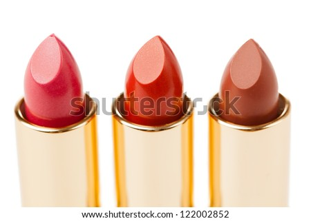 three lipsticks on white background