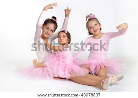 Three little ballet dancers over white background - stock photo