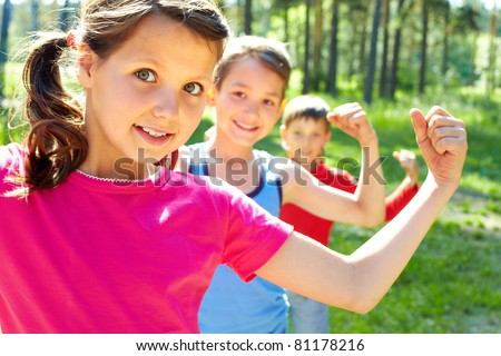 Three little children posing at camera - stock photo