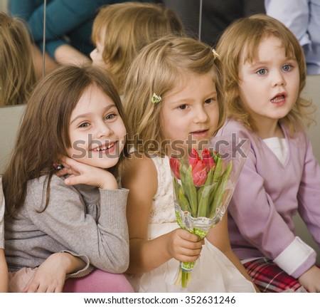 three little diverse girls at birthday party having fun close up celebration - stock photo