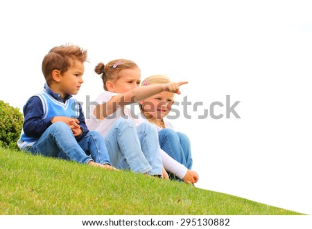 Three little friends together. Girl showing to place for your text. Happy holidays and back to school. - stock photo