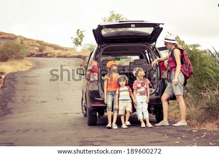 three little kids and mother in the mountains - stock photo