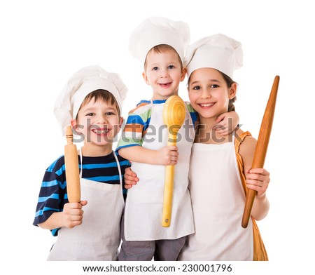 Three little smiling chefs with ladle and rolling pin, isolated on white - stock photo