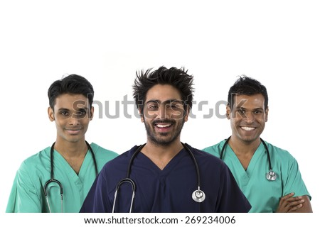 Three Male Indian doctors wearing Scrubs & stethoscope. Isolated on white background. - stock photo