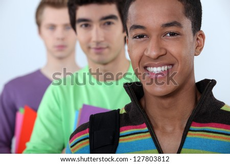 Three male student in line. - stock photo