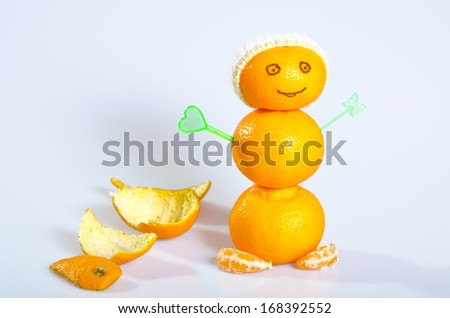 Three mandarin in human form. portrait of a knitted hat. horizontal photo - stock photo