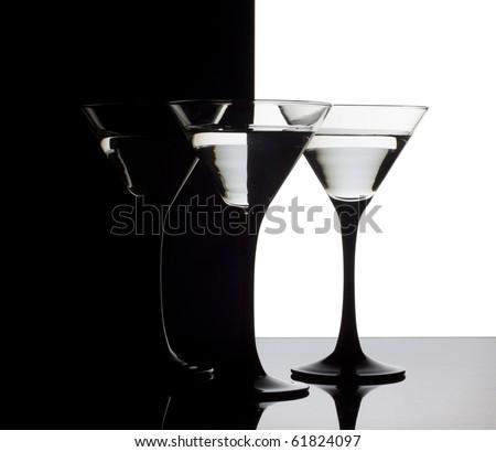 Three martini glass on a black-white  background - stock photo