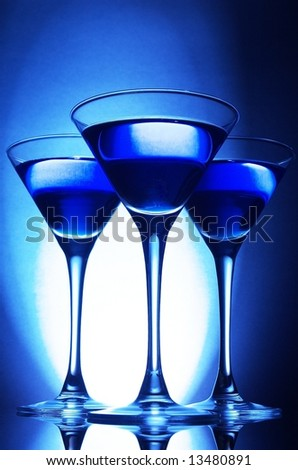 Three martini glasses in blue - stock photo