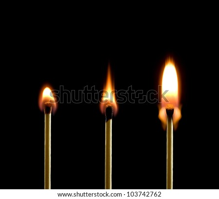 Three matches on a black background. Beautiful fire. - stock photo