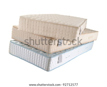 three mattresses isolated - stock photo
