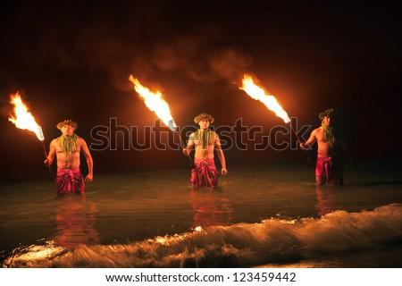 Three Maui Men Juggling Fire in Hawaii - Fire Dancers - stock photo