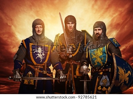 Three medieval knights against stormy sky. - stock photo